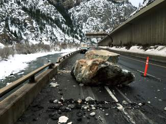 Two of the larger rocks on the eastbound lanes following the rockfall on Feb. 15.