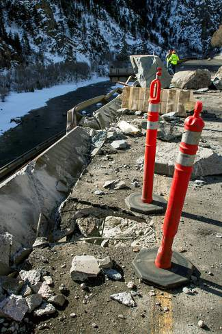 A 2-foot wide hole was left in the deck of Interstate 70's westbound lanes where a rock hit the road, bounced off of the eastbound lanes and landed in the river.