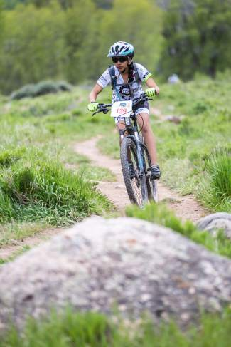 Lizbeth Andrade focuses on the approaching rock obstacles while maintaining a healthy amount of speed on the Miller Ranch open space trails May 30. The Cycle Effect provides an opportunity for young women to participate in mountain biking.