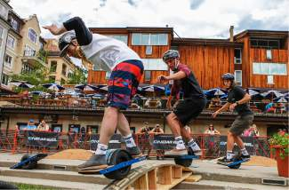 From front to back, Blake Crow, Elai Danker and Jack Mudd conquor an obsitcale course on Onewheels on June 16, 2016, in Vail.