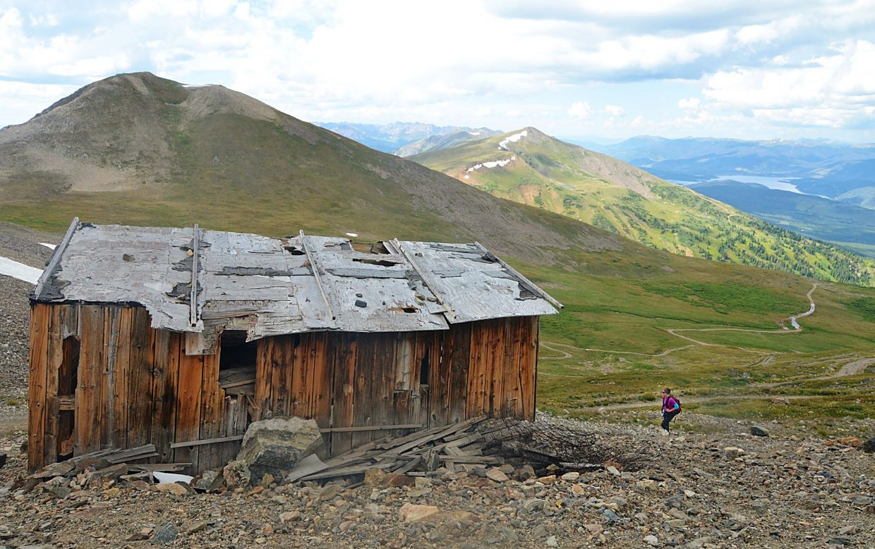 Frisco local Sara Skinner hikes past an abandoned shack on the side of the Peak 10 access road during an attempt of the Tenmile Traverse. There is no set route for the traverse, and so Skinner and our group added rouhgly 0.5 additional miles 400 vertical feet to take the road to the summit.
