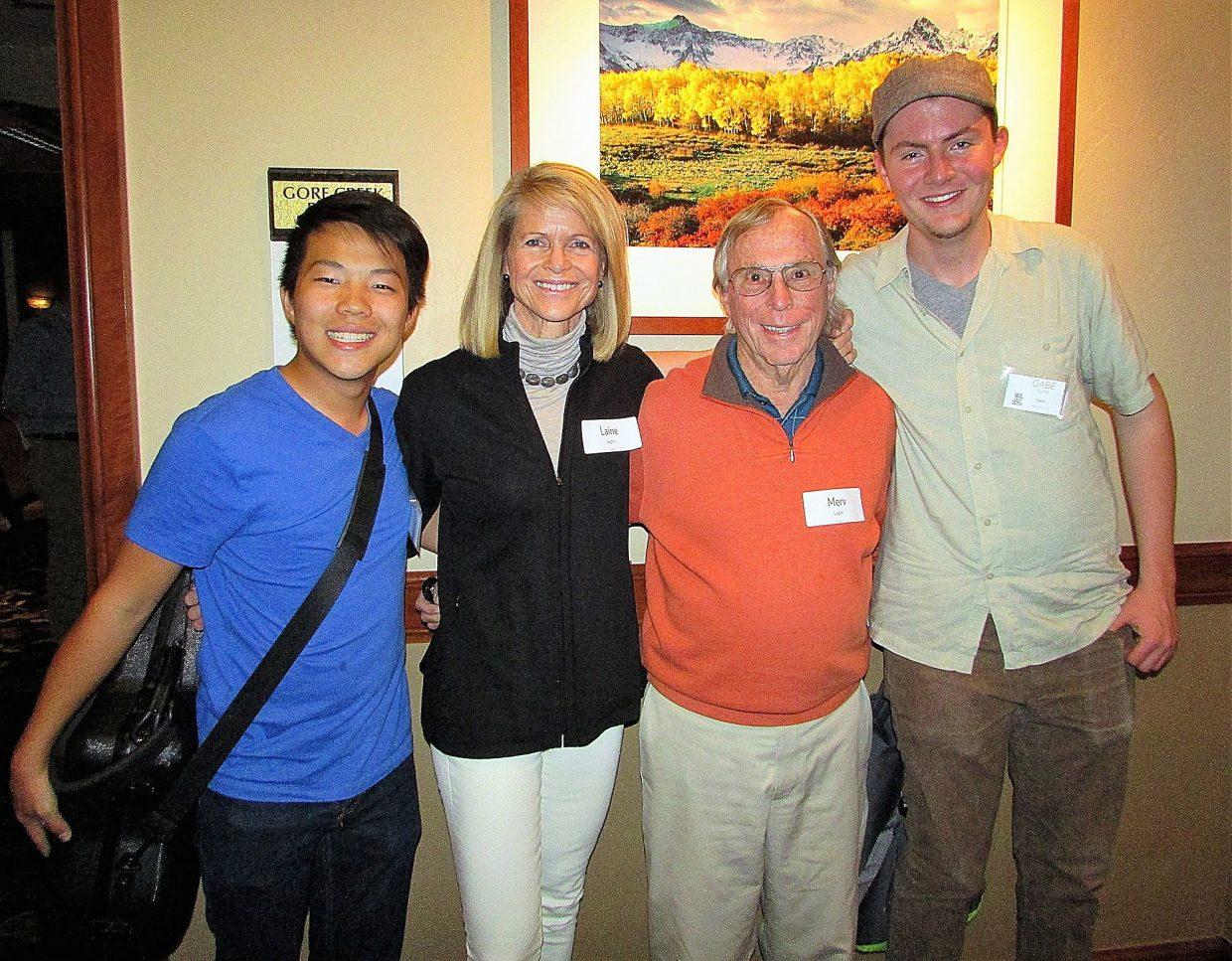 Austin Zhang and Gabe Rupe with their host family, Merv and Laine Lapin.