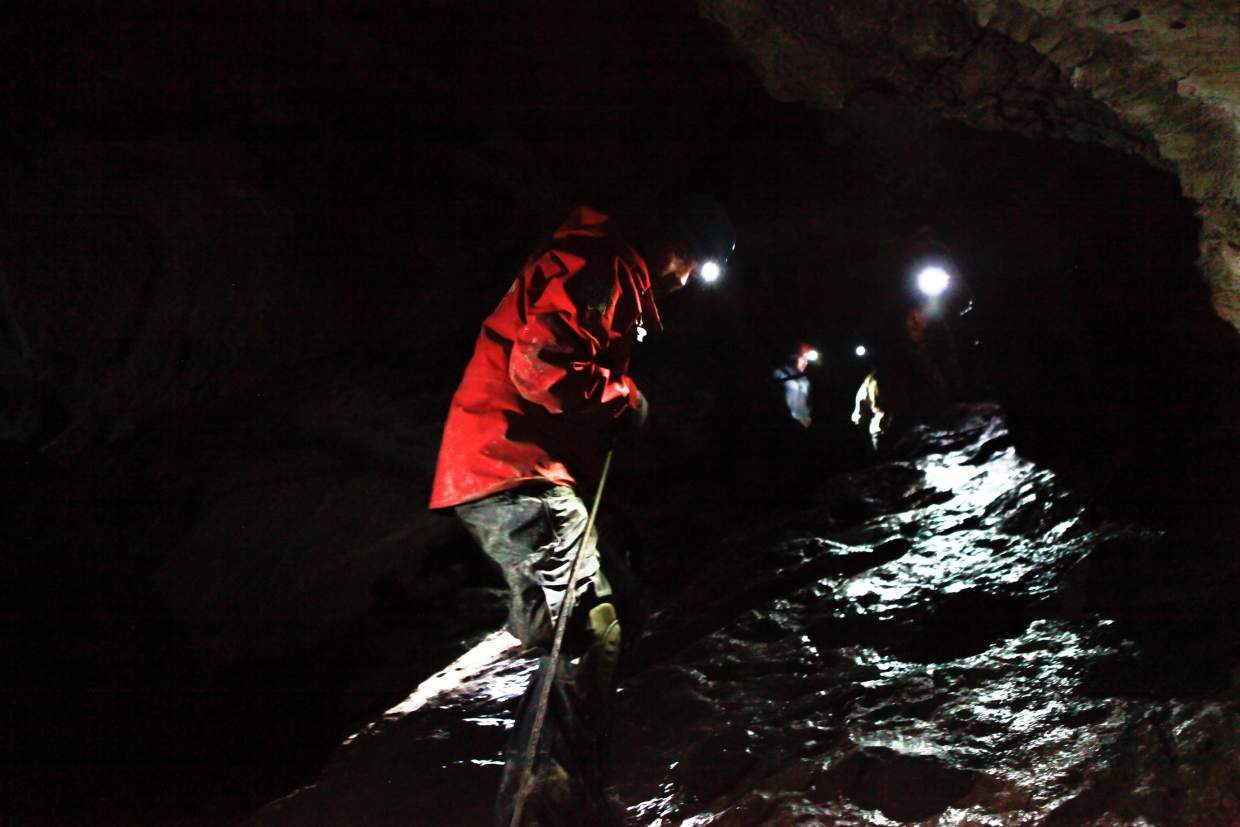 Scott Beebe with Vail Mountain Rescue works his way down a steep and slippery section of the cave using the assistance of a rope, Sunday, in Fulford Cave. Vail Mountain Rescue are co-responders with Colorado Cave Rescue Network. Rescues in caves are extremely slow going, many times playing out for days instead of hours.