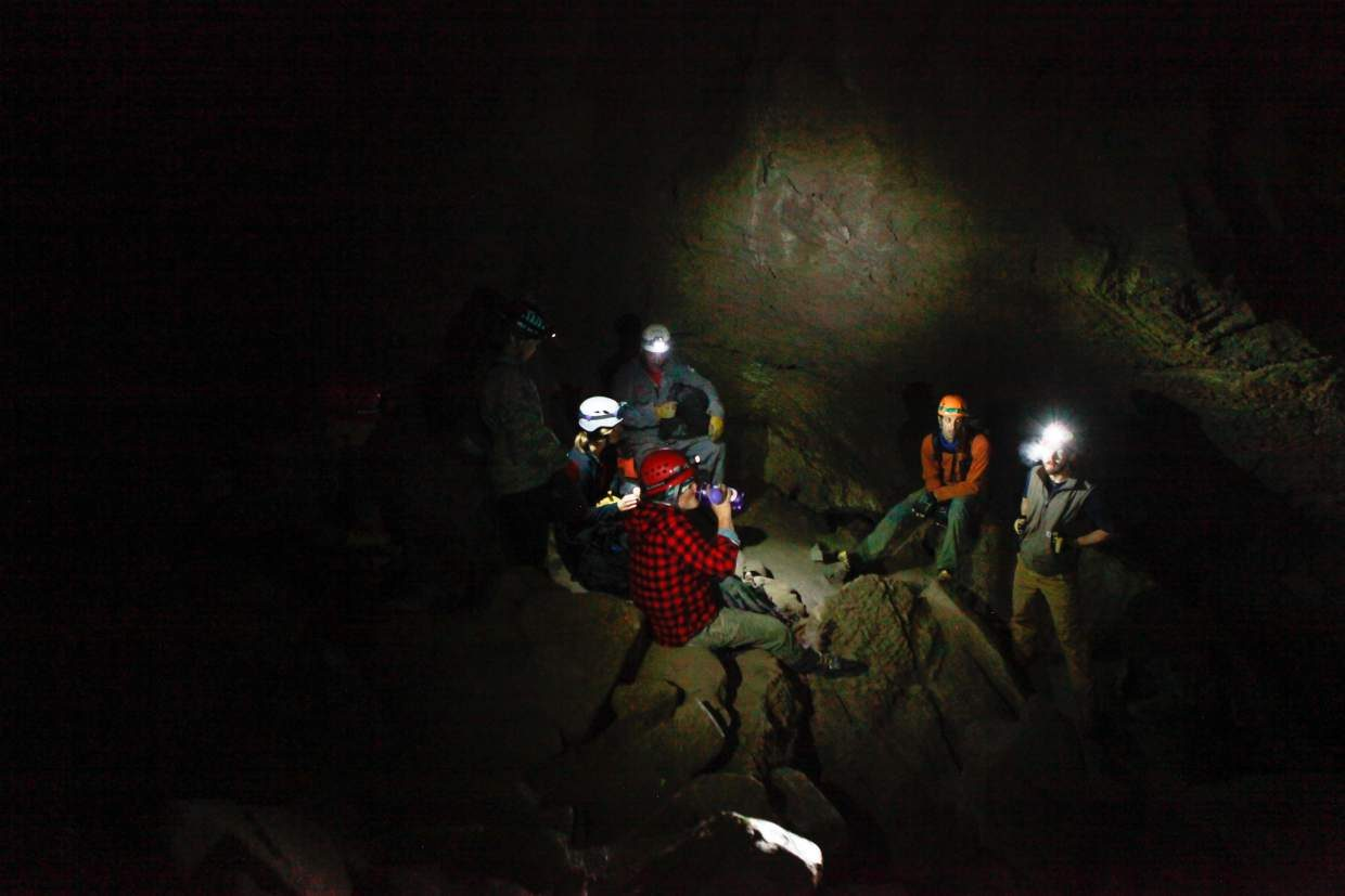 The group of volunteers from Vail Mountain Rescue Group takes a break in one of the rooms of Fulford Cave, Sunday, outside of Eagle. The cave is the eighth-largest in Colorado.