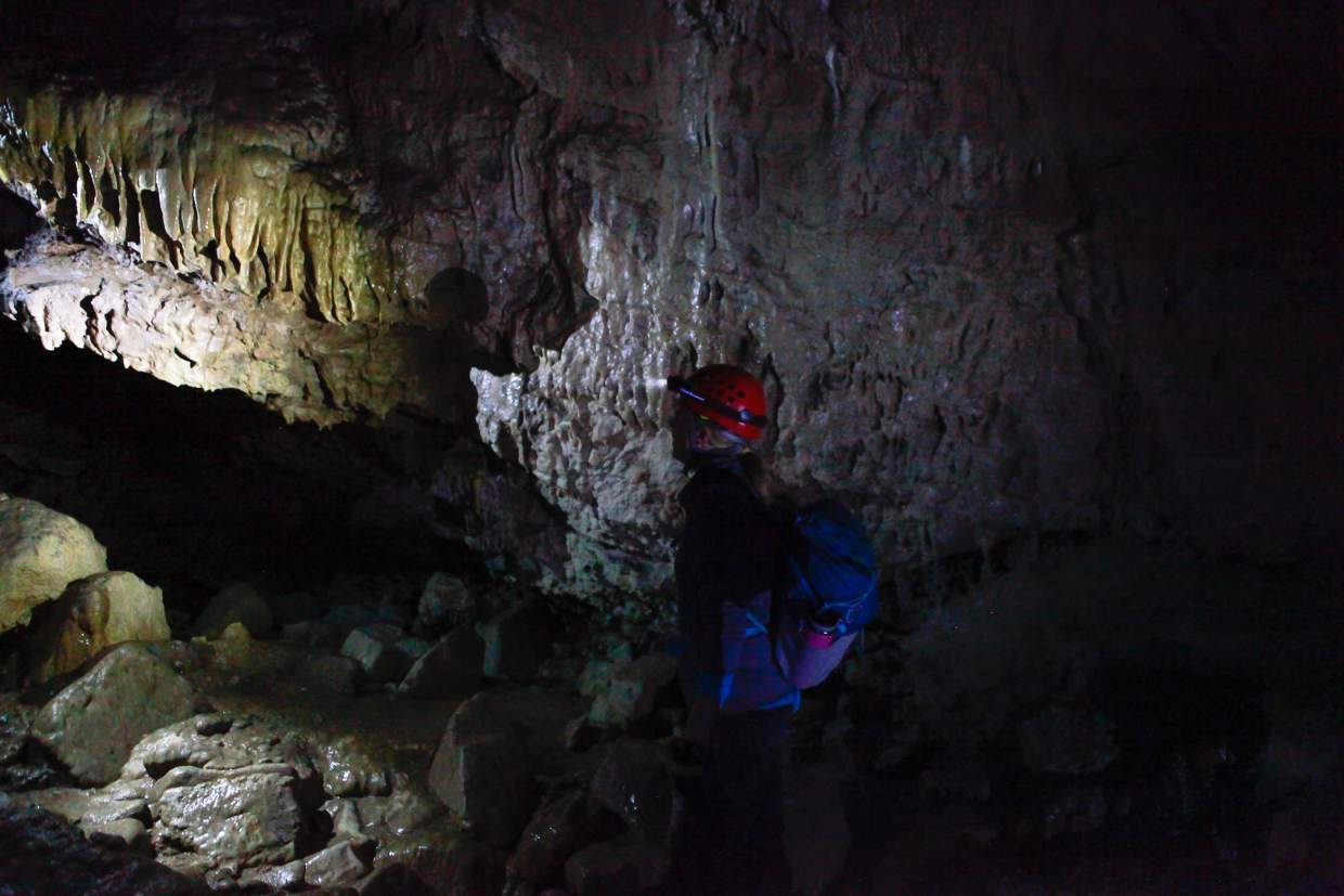 Melanie Grangaard, a volunteer with Vail Mountain Rescue, checks out the formations of mineral deposits in Fulford Cave, Sunday, near Eagle. The cave closes for the season, Sunday, but a permit is required to enter when open.