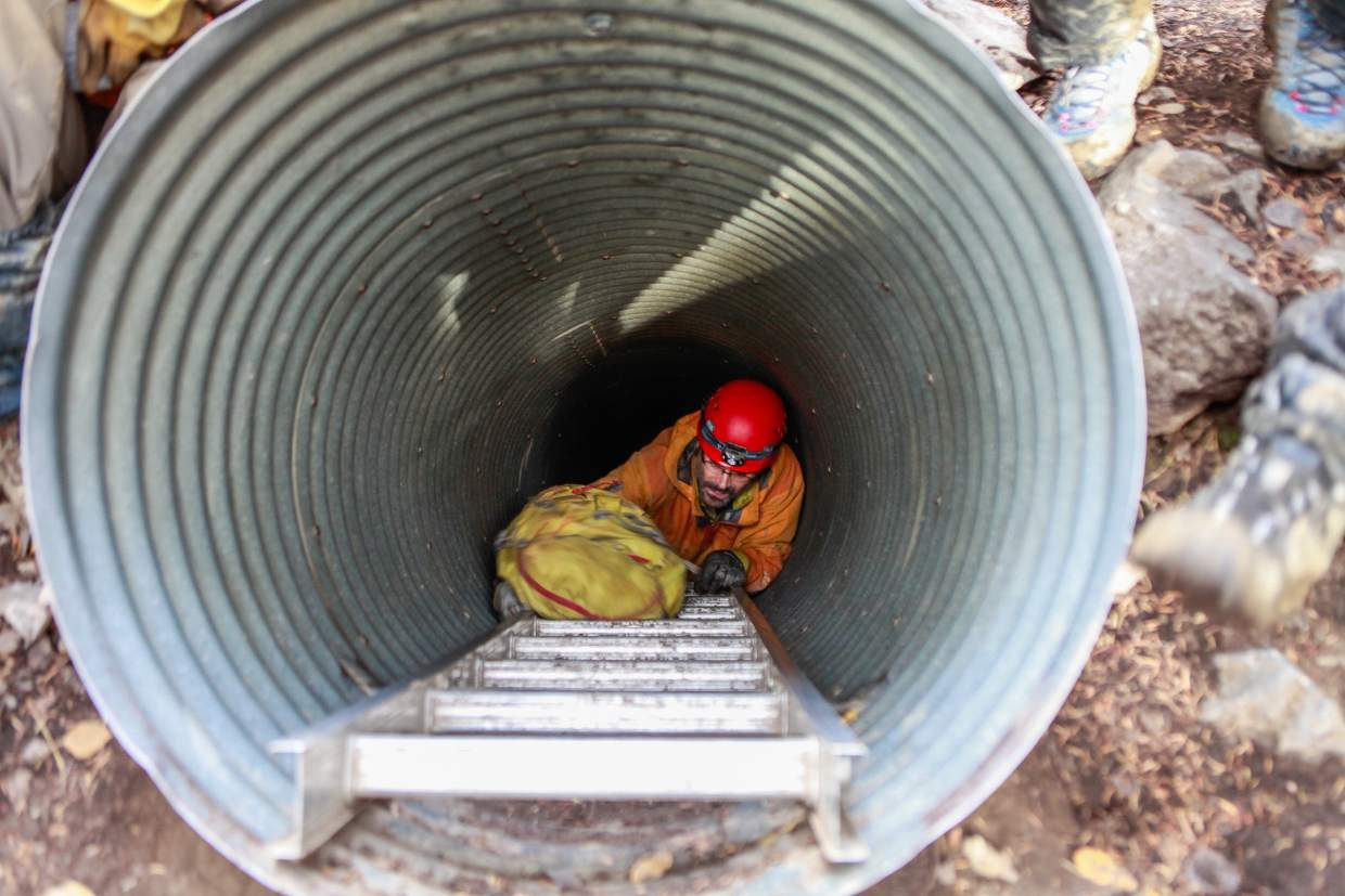 Sean O'Brien makes his way out of Fulford Cave, Sunday, near Eagle. A group of volunteers and Vail Mountain Rescue held a training exercise on what to expect during a cave rescue. Since the cave started requiring permits, there have been no calls for rescue in Fulford Cave.