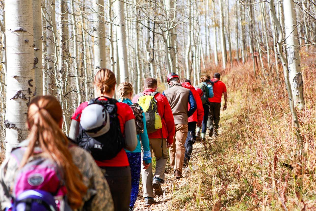 The group of volunteers with Vail Mountain Rescue makes their way up the trail to the entrance of Fulford Cave, Sunday, near Eagle. Fulford cave was discovered in 1892 by miners in Fulford.