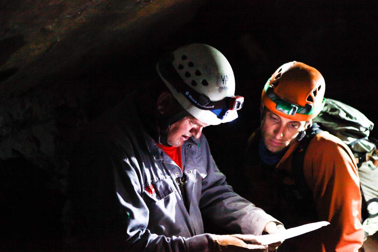 Jesse Horton, right, and Scott Sutton with Vail Mountain Rescue Group check the map of the passages in Fulford Cave Sunday by Sylvan Lake State Park. The rescue group was conducting a training exercise to show rescuers where people could get stranded.