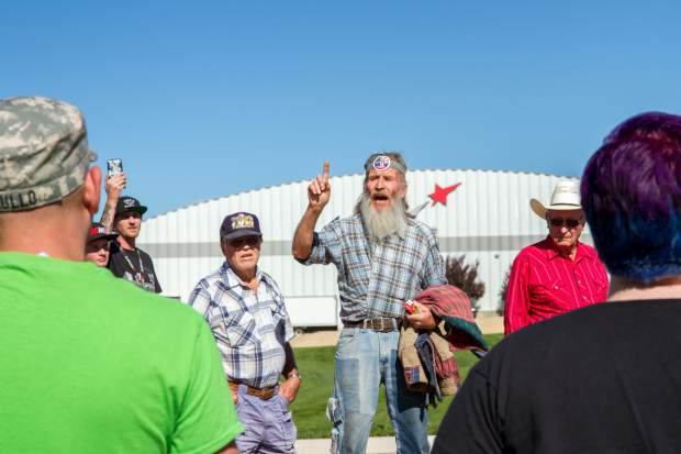 Donald Trump supporters argue with protesters while waiting in line to get into the rally at the Grand Junction Regional Airport Tuesday afternoon.