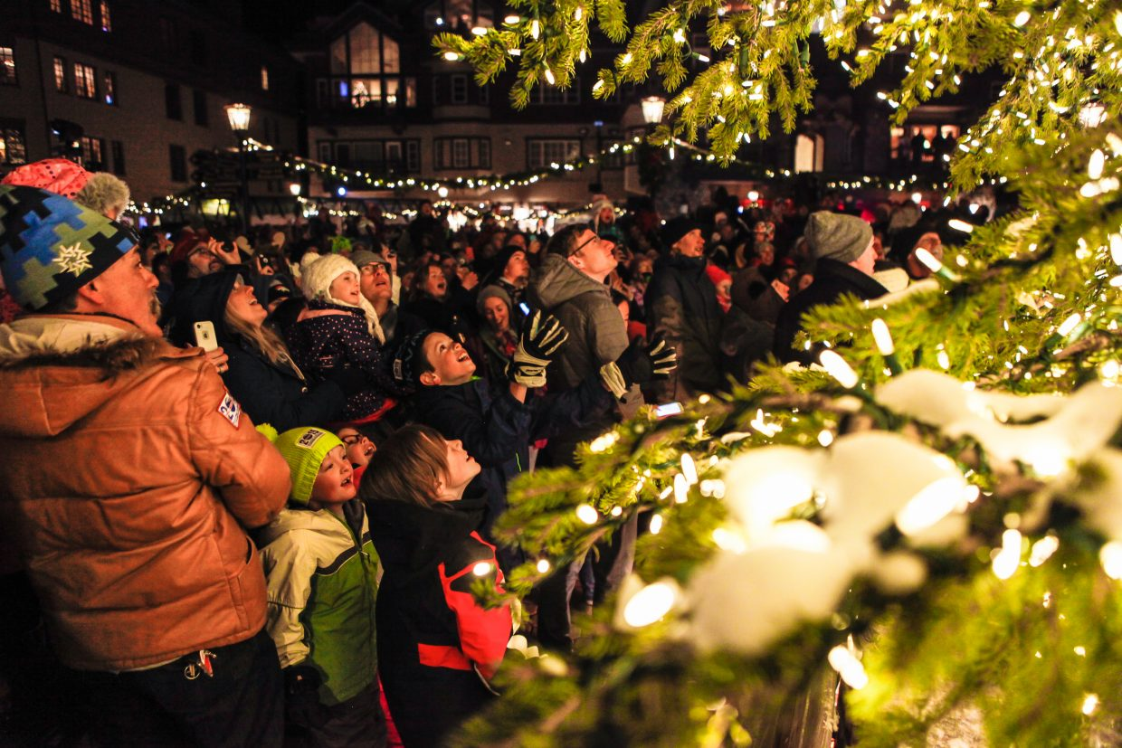 People look up in amazement as the tree is lit for the annual day-after-Thanksgiving Day celebration on Friday in Beaver Creek. Professional ice skaters, live music, the tree lighting, Santa Claus and fireworks were just some of the entertainment for thousands of people in Beaver Creek.