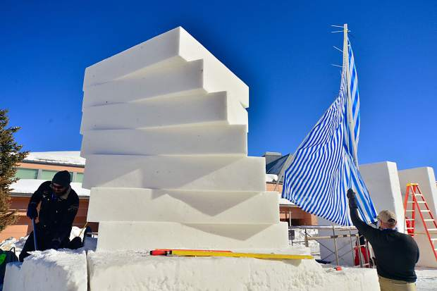 Team USA-Loveland covers their snow sculpture Wednesday in Breckenridge. The four-man squad has named their piece