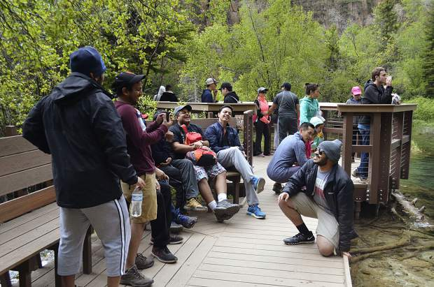 The Hanging Lake parking lot is currently organized but overrun. And the U.S. Forest Service's new proposal will look to implement a shuttle system rather than continuing to allow visitors to drive to the trailhead.