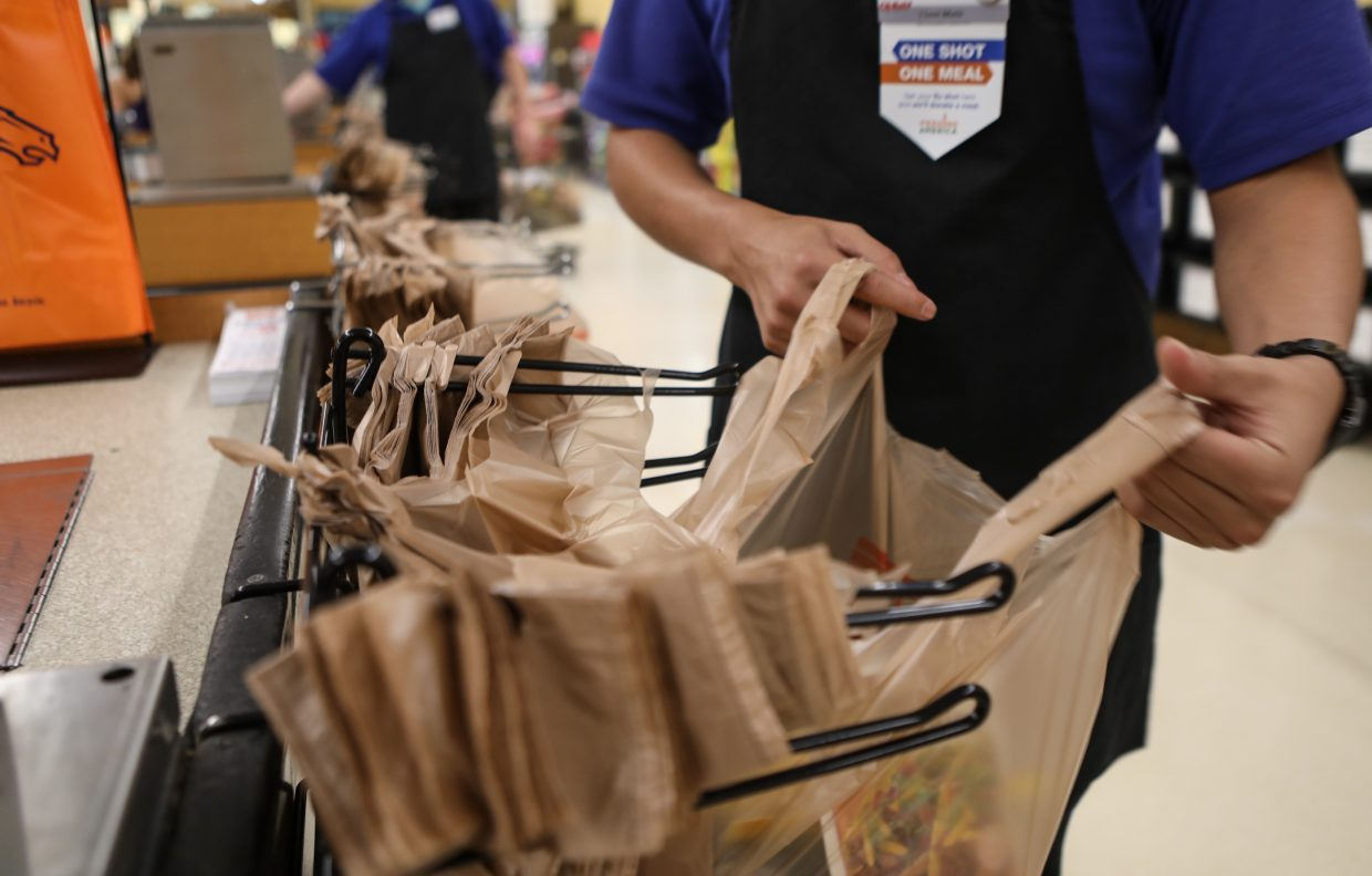 Groceries are bagged in plastic Wednesday, Sept. 13, at the City Market in Avon.