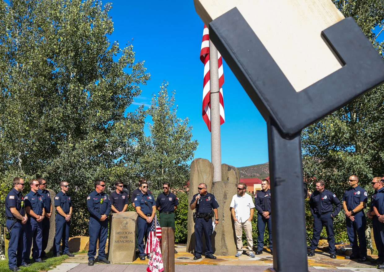 Avon Police Department Officer Al Zepeda speaks at the 9/11 Memorial Monday, Sept. 11, at Freedom Park with a peice of the Pentagon in the foreground in Edwards. A procession of first responders made its way from Vail to Edwards to pay tribute to those who lost their lives trying to save other 16-years-ago during the terrorist attacks on U.S. soil.