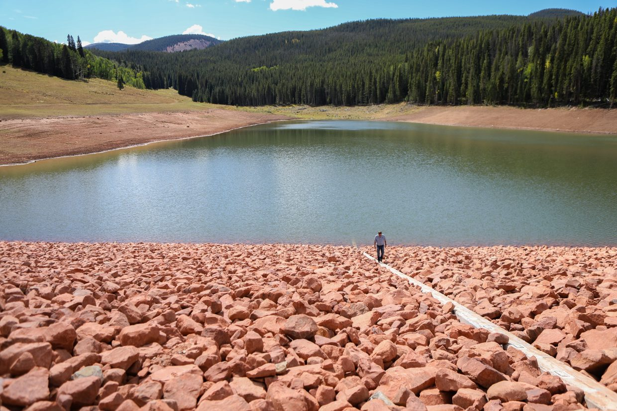 Jeff Shroll, Gypsum Town Manager, checks the water level indicator on the newly-redone L.E.D.E Reservoir Thursday, Sept. 14, in Gypsum. The reservoir and dam underwent a three-year overhaul expanding the size.