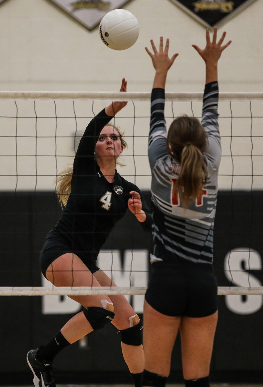 Battle Mountain's Lillian Benway tips the ball to Steamboat Springs' side Thursday, Sept. 14, in Edwards. The Huskies face Glenwood Springs Tuesday, Sept. 19, in Glenwood.
