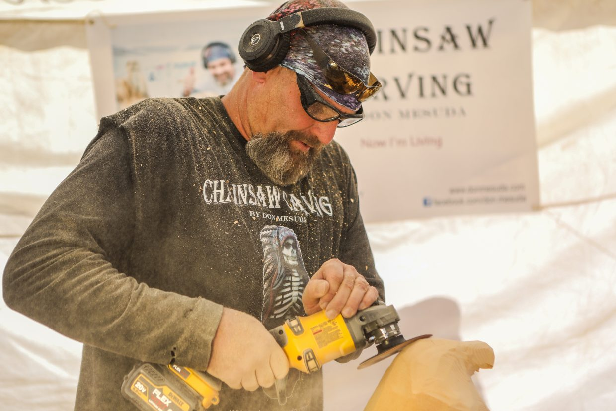Don Mesuda carves into a chunk of wood with a chainsaw for Beaver Creek's Hike to the Mic weekend event Friday, Sept. 15, in Beaver Creek.