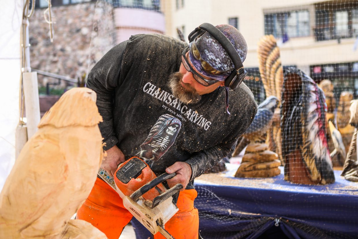Don Mesuda carves into a chunk of wood with a chainsaw for Beaver Creek's Hike to the Mic weekend event Friday, Sept. 15, in Beaver Creek. Mesuda was turning the ordinary log into an eagle.