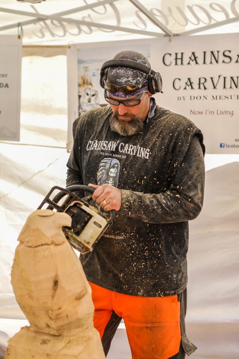 Don Mesuda starts to define the eagle with a chainsaw for Beaver Creek's Hike to the Mic weekend event Friday, Sept. 15, in Beaver Creek. Mesuda lives in New York state.
