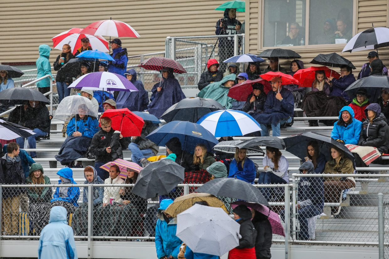Hardy Vail Christian fans tough out the cold and rain during the game against Hotchkiss Saturday, Sept. 23, in Edwards.