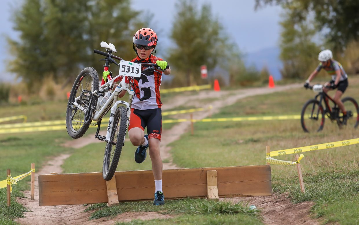 Racers hurdle obstacles in the cyclocross race Wednesay, Sept. 27, in Eagle.