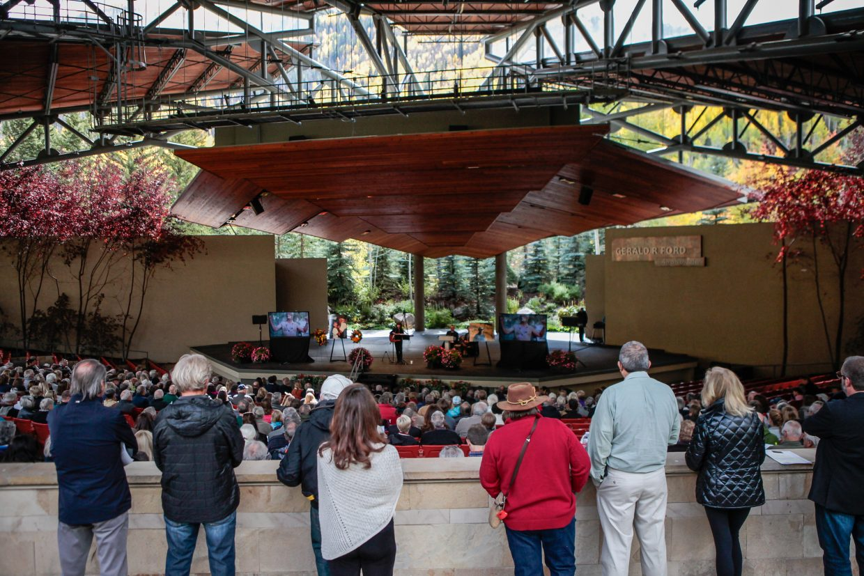 People watch Pat Hamilton play at Byron Brown's memorial Friday, Sept. 29, in Vail. Hundreds showed up to pay their respects.