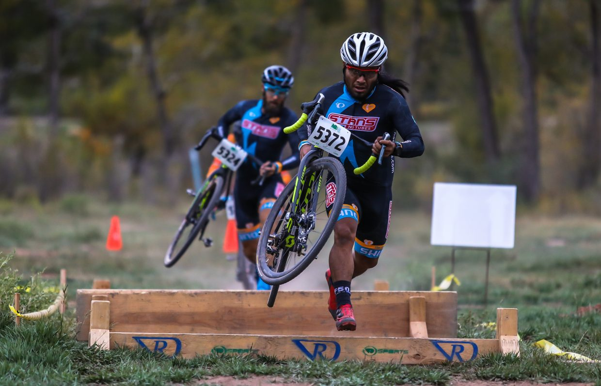 Racers make their way over obstacles during the pro race in the Vail Recreation District's Cyclocross race Wednesday, Sept. 27, in Eagle. The race had four divisions from kids to pros.