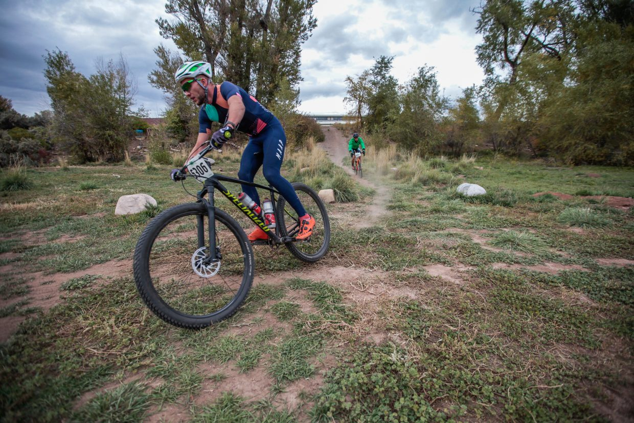 Racers fly down the course in the cyclocross race Wednesay, Sept. 27, in Eagle.