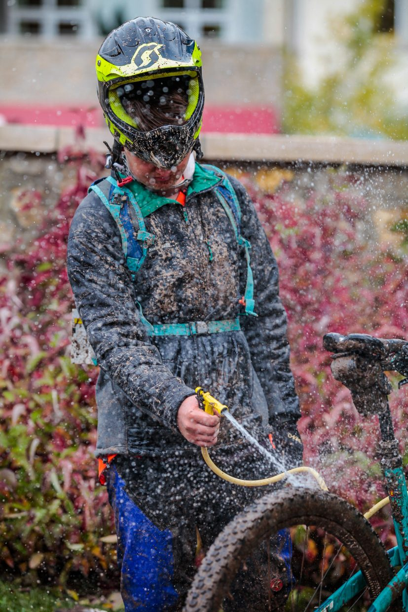 Riders wash off their bikes after a muddy RockShox Enduro for the Outlier Offroad Festival Sunday, Oct. 1, in Vail.