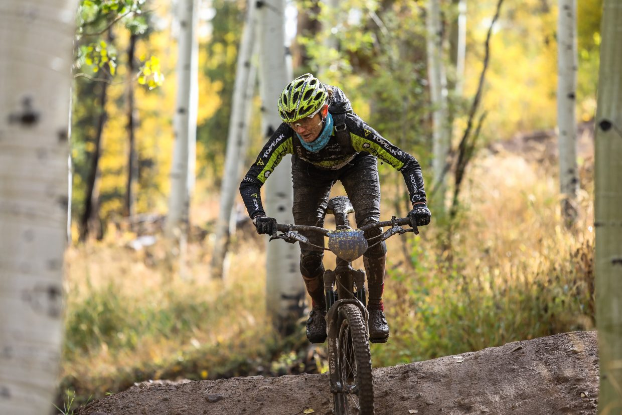 Karen Jarchow doesn't let mud stop her on Mane Lane trail during the Rockshox Enduro race of the Outlier Offroad Festival Sunday, Oct .1 in Vail.