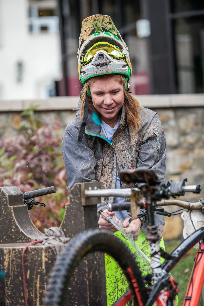 Jacqui Ball of Aspen rinses her bike of all the mud after the Rockshox Enduro race of the Outlier Offroad Festival Sunday, Oct .1 in Vail.