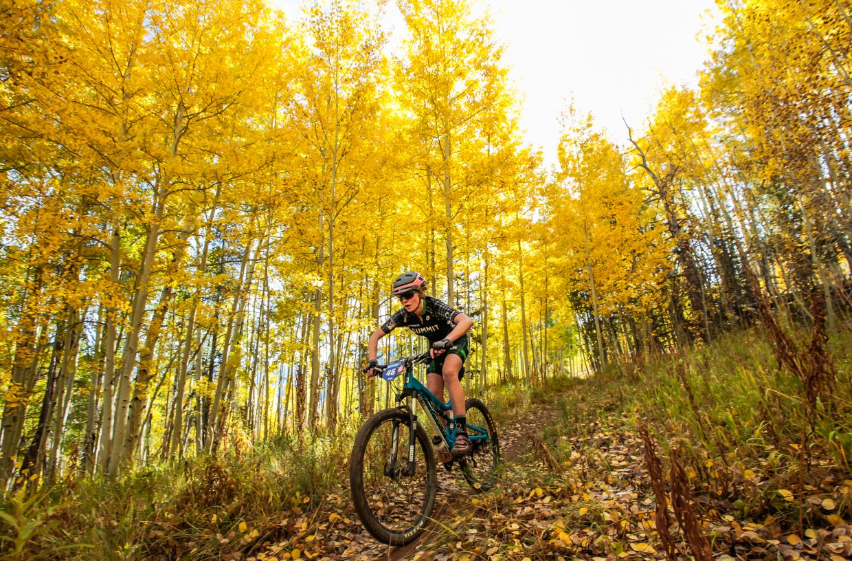 Elsa Bates of Summit crusises beneath the colors of the apens on Onza Alley for the Scott Spark XC race for the Outlier Offroad Festival Saturday, Sept. 30, in Vail. Bates took first in the junior women 15-18 medium course.
