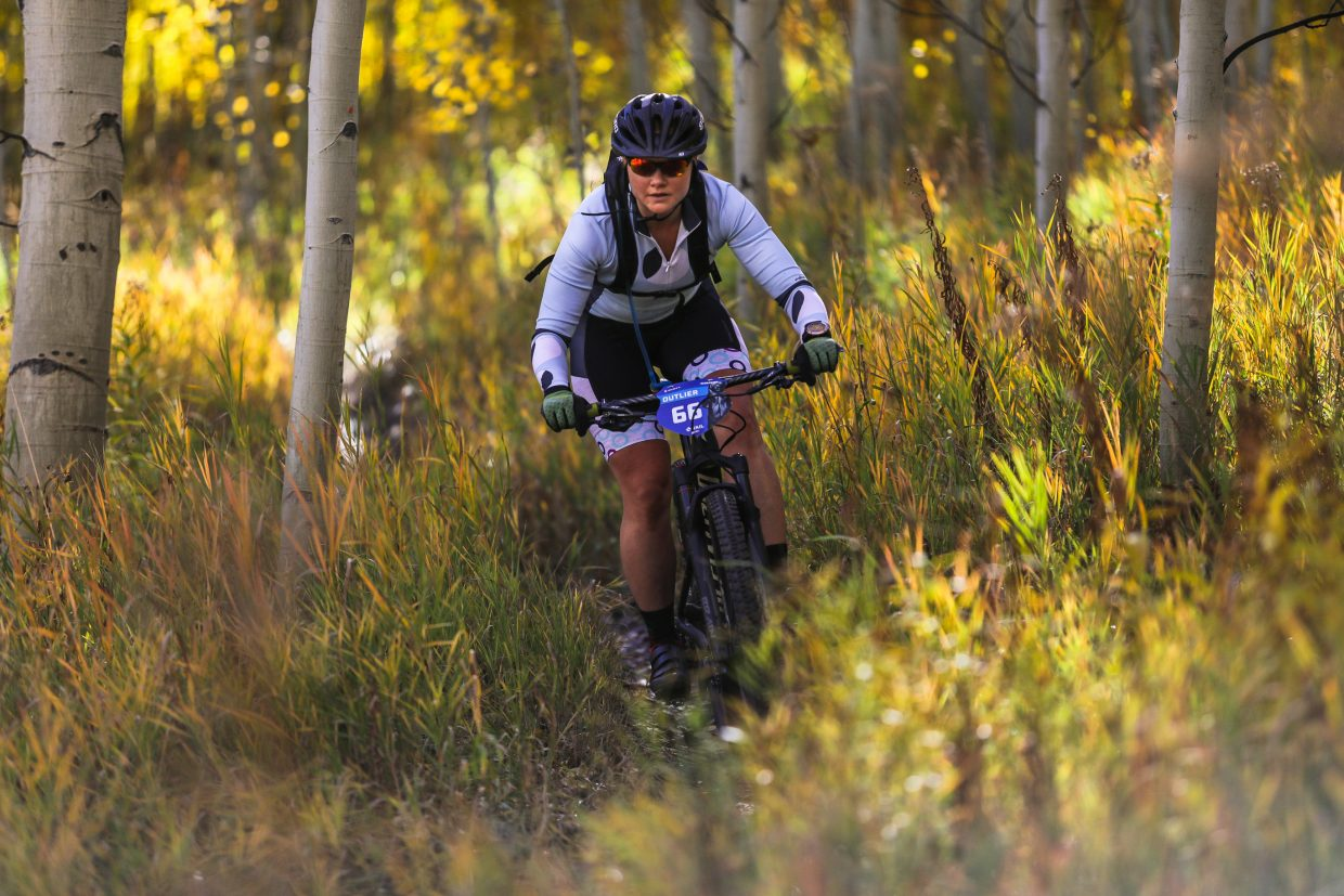 Janel Klug makes her way down Onza Alley Trail during the Scott Spark XC for the Outlier Offroad Festival Saturday, Sept. 30, in Vail.