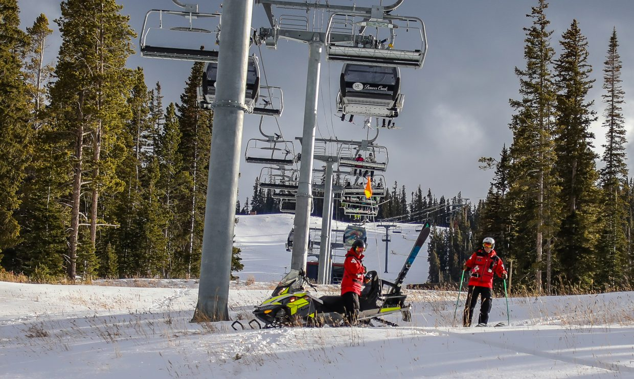 Members of Beaver Creek Ski Patrol work to get more of the mountain open Friday, Nov. 24, in Beaver Creek. Many on-mountain jobs require a lot of physical work, making for a good workout.
