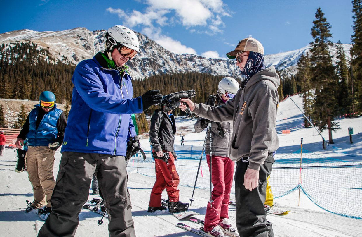 Arapahoe Basin ticket scanner Austin Fellenz scans guest's tickets and passes Thursday, Nov. 2, at Arapahoe Basin in Summit County. The ski hill is in partnership with the Epic Pass, where Epic Pass holders can ski Arapahoe Basin as part of the pass.