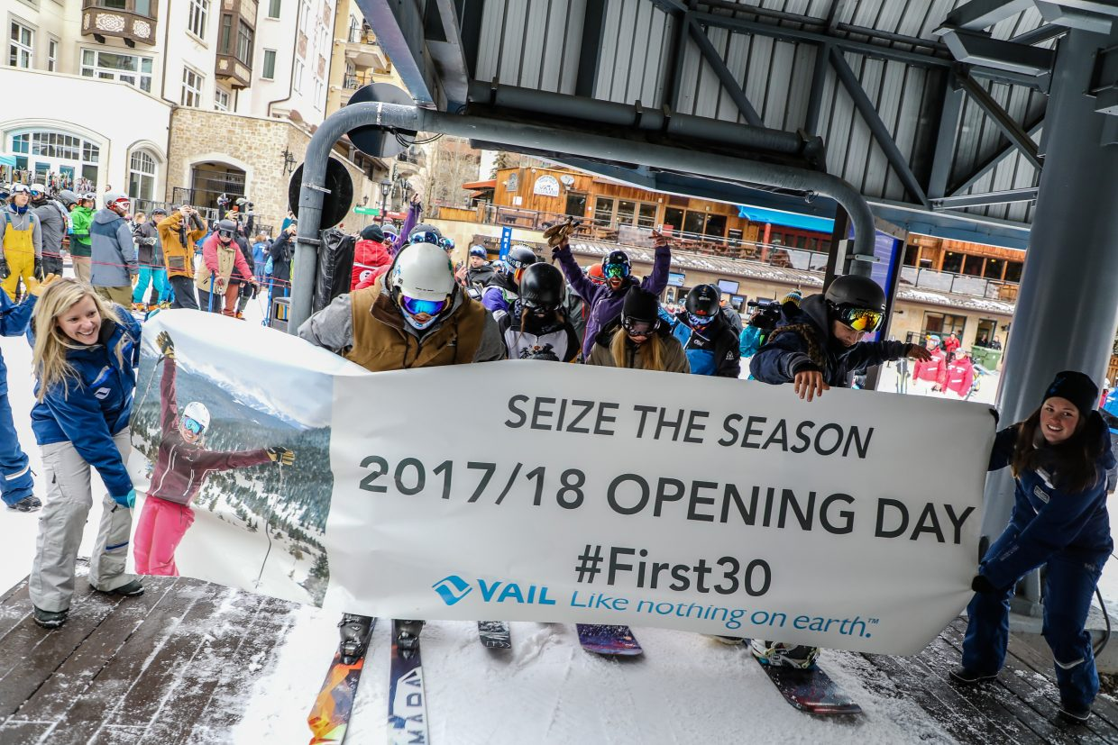 People snag the first chair of the season during Vail Mountain's Opening Day Wednesday, Nov. 22, in Vail.