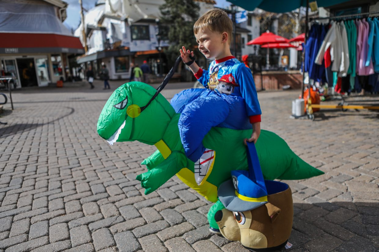 Josiah Drew of Edwards walks in his inflatable dinosaur costume trick-or-treating for the annual Trick or Treat Trot through the Vail Recreation District Tuesday, Oct. 31, in Vail. Merchants in Vail and Lionshead Village opened doors to trick-or-treaters on Halloween.