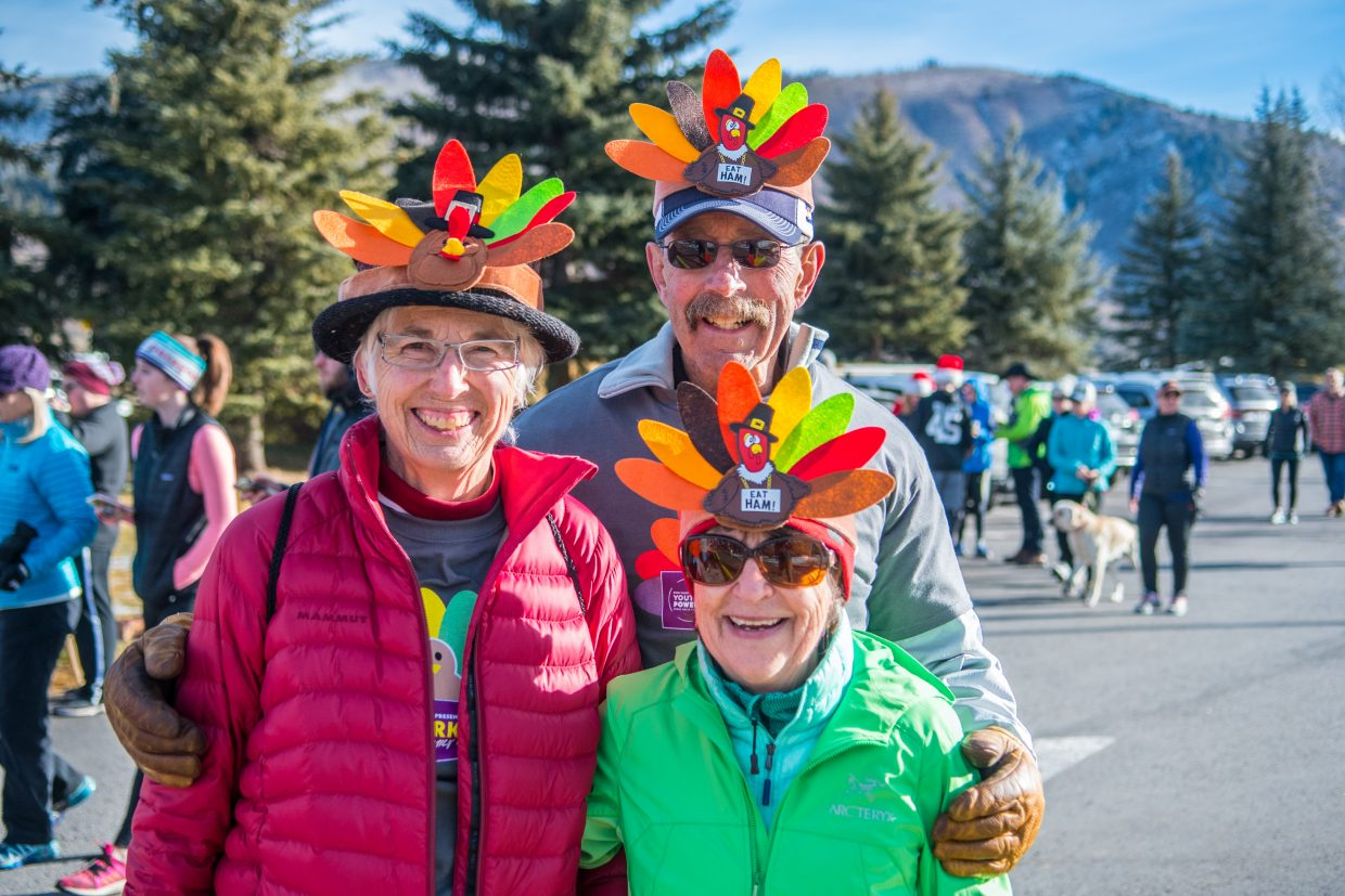 Louise Powers, Graham Powers, and Carol Trueblood show their enthusiasm for Thanksgiving a the YouthPower365 annual event. Families turned out from all over the community to gather together on this day of celebration.