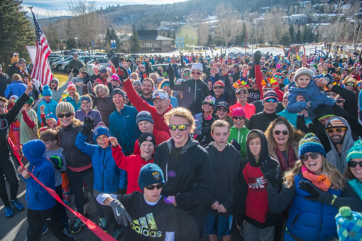 The crowd for this year's Turkey Trot was very enthusiastic as the race began.