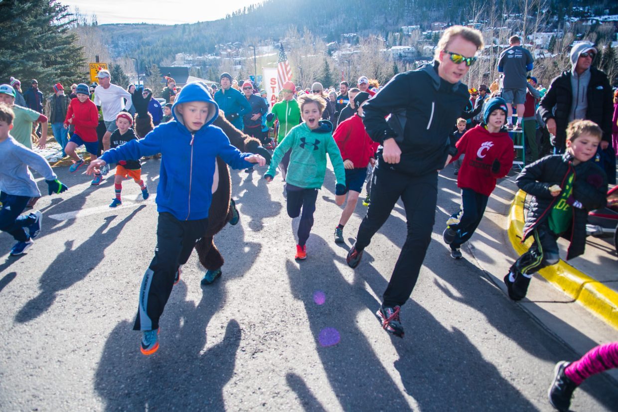 Kids start out strong around the first bend of the 5K course on Thursday morning.