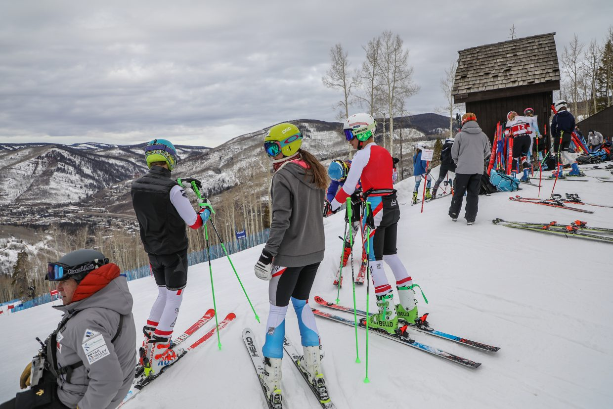 Skiers hang out at the start gate before their training runs at the newly-opened Golden Peak Training Center Monday, Nov. 20, in Vail.