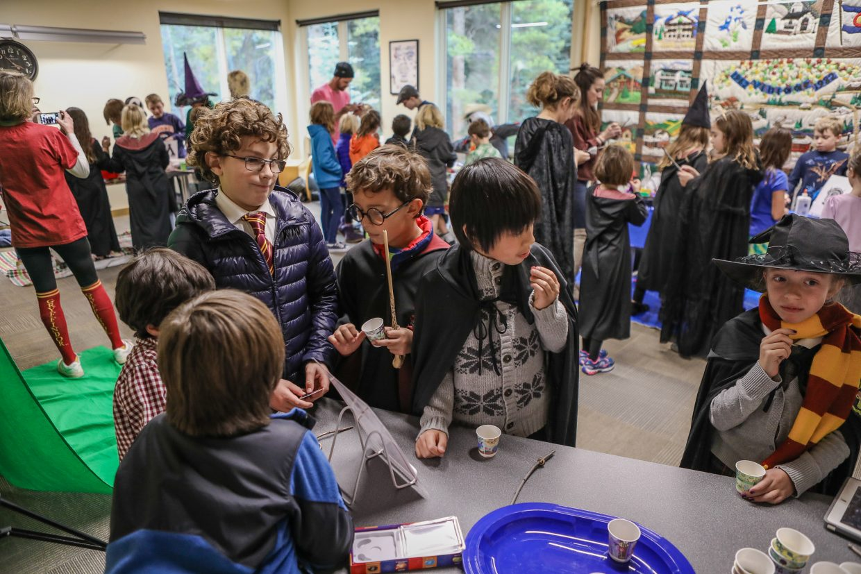 Kids sample jellybeans to figure out what flavor during the Harry Potter Party Saturday, Nov. 4, at the Vail Public Library in Vail. The tech studio was also demonstrating three dimensional printing.