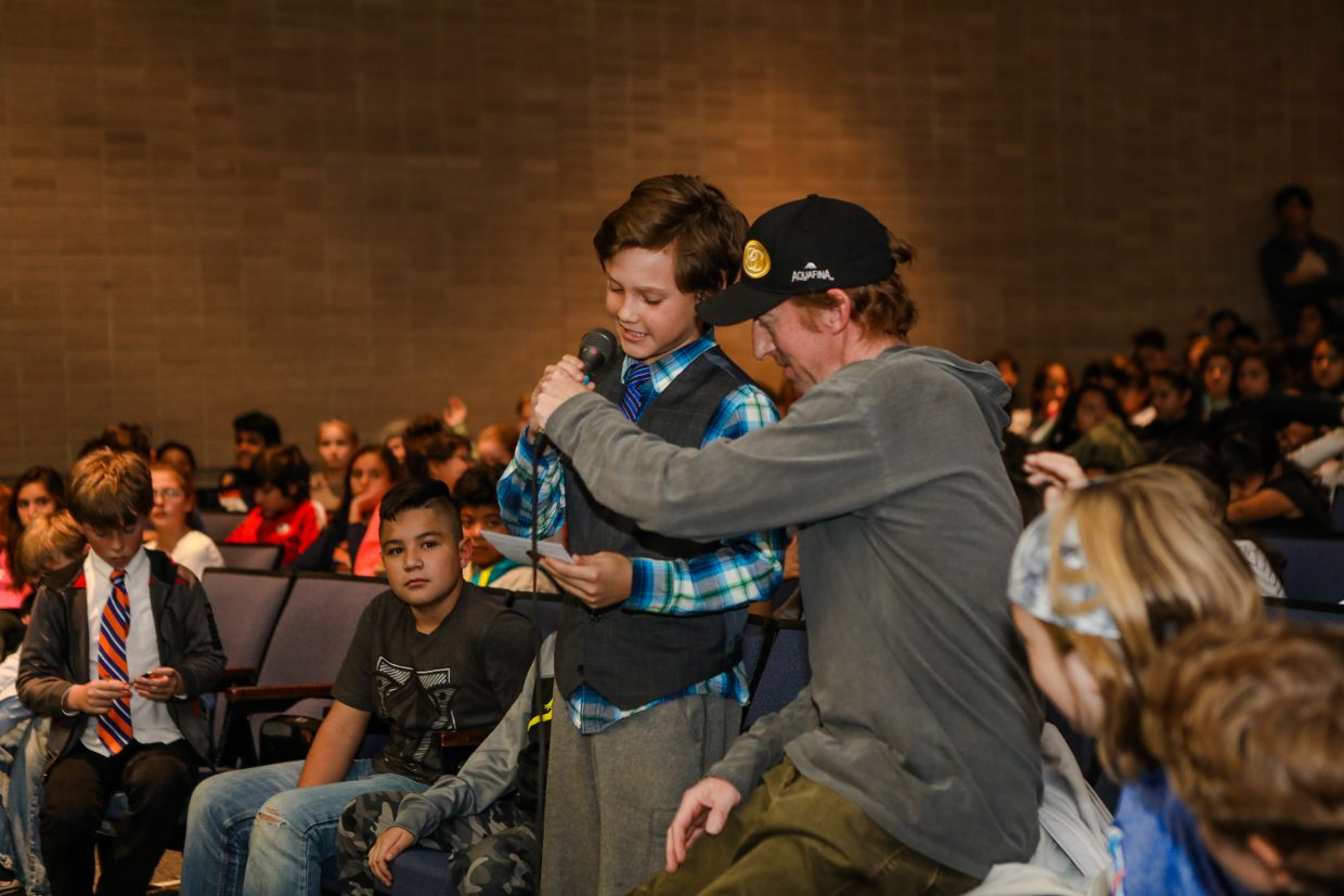 Sixth-grader at Homestake Peak School, Jack Kovacik, asks a question to members of the U.S. Ski Team while professional skier and emcee Chris Anthony holds the mic Wednesday, Nov. 29, in Eagle-Vail. Students were able to ask questions from the three skiers in attendence through the Vail Valley Foundation and YouthPower365.