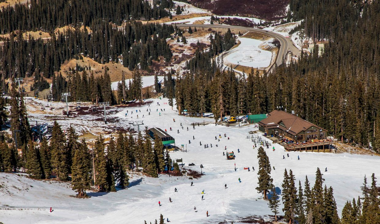 People ski and snowboard at Arapahoe Basin Thursday, Nov. 2, in Summit County. A storm is expected to move in throughout the weekend into next week, giving way to more terrain opening.