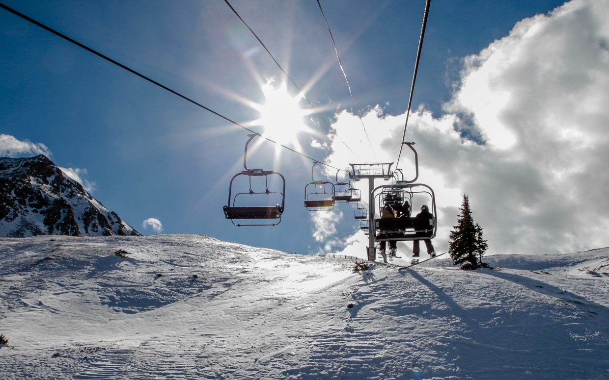 People ride the Lenawee Mountain Lift to the top of Arapahoe Basin Thursday, Nov. 2, in Summit County. The lift opened Wednesday, Nov. 1, for top-to-bottom access.