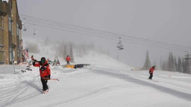 Skiers take to groomed trails early Saturday morning at Breckenridge Ski Resort after Friday's storm dumped a foot of snow at Breckenridge.