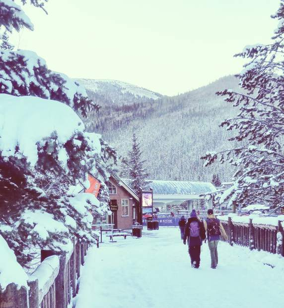 Skiers and snowboarders walk toward the River Run Gondola at the base of Keystone's Dercum Mountain early Saturday morning.