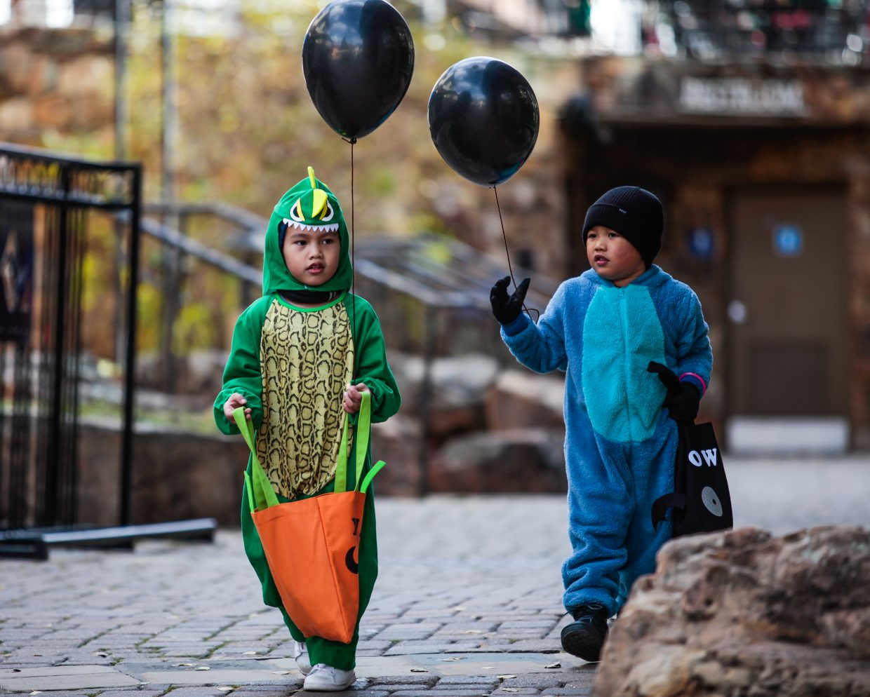 Owen Moreno and Xian Cabrera make their way through Vail Village trick or treating during the annual Trick or Treat Trot through Vail Recreation District Tueday, Oct. 31, in Vail. Leftover candy will be donated to soliders and veterans.