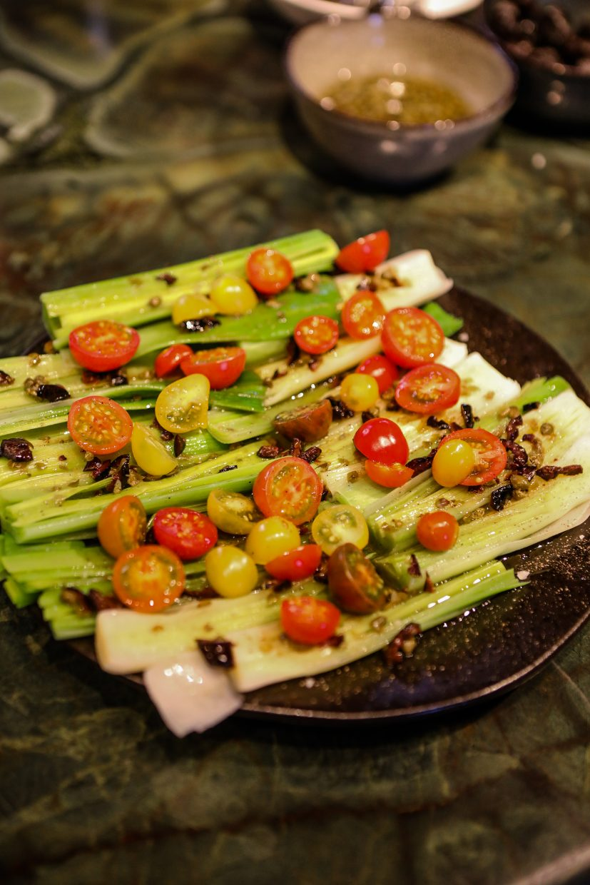 Grilled leeks and tomatoes cooked by celebrity chef, Alex Guarnaschelli cook for guests during Beaver Creek Culinary Weekend on Saturday, Jan. 20, at Splendido in Beaver Creek. The chef cooked lunch, and answered all questions, while patrons looked on at the Chateau.