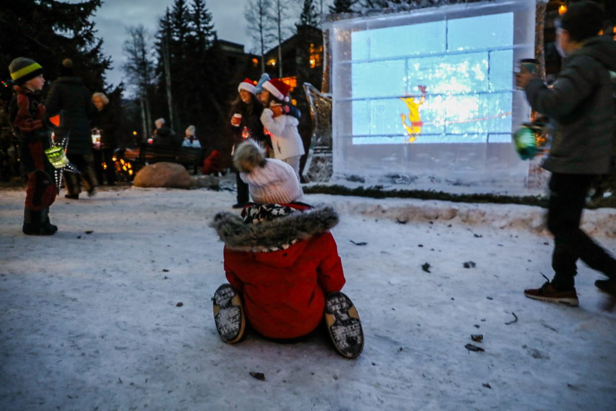 A girl watches How the Grinch Stole Christmas at the Ice Theater in Vail.